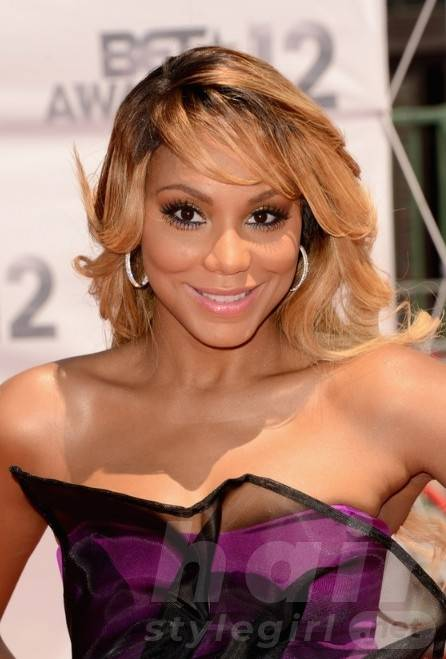 Tamar Braxton Long Wavy Hairstyle with Bangs for Black Women