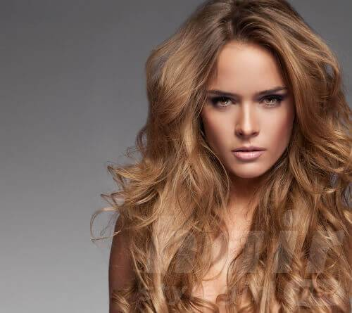 long-blonde-hairstyle-with-curls-and-volume