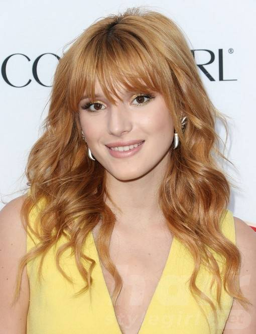 Bella Thorne Long Hairstyles: Wavy Hairstyle with Blunt Bangs
