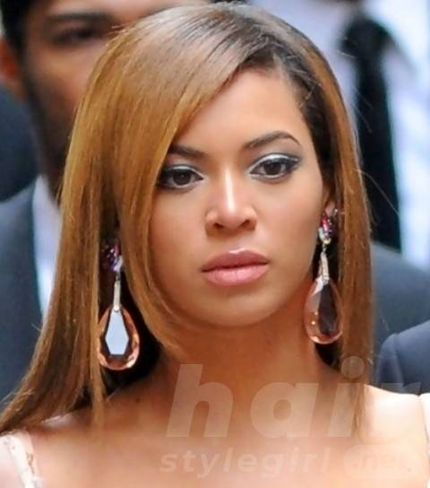 Beyonce Hairstyles: Slick Long Straight Haircut with Bangs