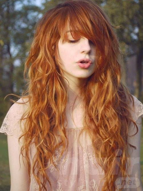 Red Colored Long Curly Hairstyle