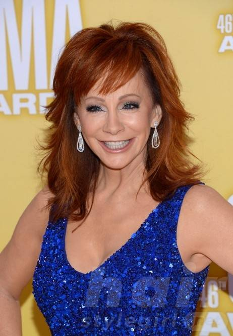 Reba McEntire Medium Layered Red Hairstyle for Summer